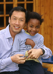Dr. Lam with a little girl